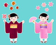 Cute Japanese girls. Japanese girls in kimonos of autumn and spring Stock Photography
