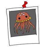 Cute jellyfish cartoon in polaroid Royalty Free Stock Image