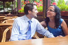 Cute joyful couple at restaurant table Stock Photos
