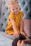 Cute joyful girl stretching out her hand Royalty Free Stock Photo