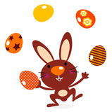 Cute jumping bunny juggling with eggs vector illustration
