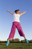 Cute jumping girl in fisherman pants Royalty Free Stock Image