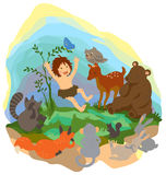 A cute jungle boy is reading book to animals in th Royalty Free Stock Images