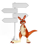 Cute Kangaroo cartoon character with way sign Royalty Free Stock Photo
