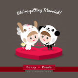 Cute kawaii groom and bride character. In rabbit and panda helmet ready to get married Royalty Free Stock Photo