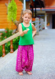 Cute kid in asian style clothes holding flower Stock Image