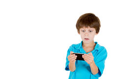 A cute kid astonished at a cellphone Stock Photos