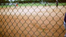 Cute kid batting during baseball practice stock video