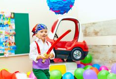 Cute kid, boy dressed like pirate on playground Stock Photos