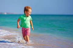Cute kid boy having fun on the sea beach Royalty Free Stock Image