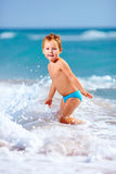 Cute kid boy having fun in sea surf, crimea Stock Photography