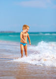 Cute kid boy having fun in sea surf Royalty Free Stock Photography
