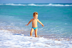 Cute kid boy having fun in sea surf Royalty Free Stock Photos