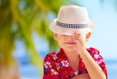 Cute kid boy hiding his face behind hat Stock Images