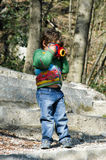 Cute kid boy photographing Royalty Free Stock Photography