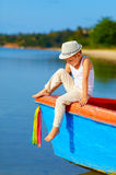 Cute kid, boy sitting on the bow of a boat Royalty Free Stock Images