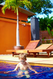 Cute kid, boy swimming in hotel pool. Cute kid, boy swimming in hotels pool Stock Images