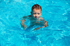 Cute kid, boy swimming in pool water Royalty Free Stock Photos