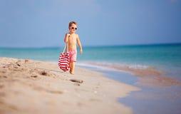 Cute kid boy walking the sea beach Stock Photo