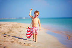 Cute kid boy walking the sea beach Royalty Free Stock Photo