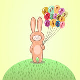 Cute kid in bunny costume holding balloons. Royalty Free Stock Photography