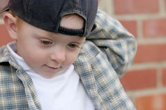 Cute kid with cap Royalty Free Stock Images