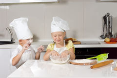 Cute Kid Chefs Baking While Playing Stock Photography
