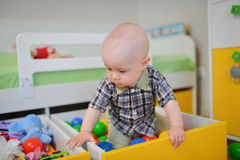 Cute kid or child playing colorful balls looking down Royalty Free Stock Photography
