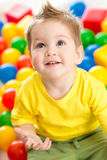 Child playing colorful balls top view Stock Photos
