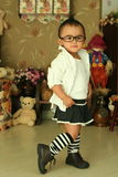 A cute kid of china. With glasses Stock Images