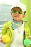A cute kid of china. With glasses and two balls Stock Photos