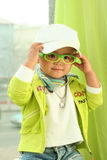 A cute kid of china. With glasses and two balls Royalty Free Stock Image