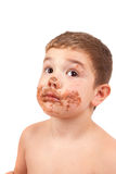 Cute kid with chocolate on his face Royalty Free Stock Photos