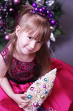 Cute kid with Christmas tree Stock Photography