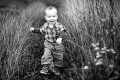 Cute kid closeup portrait in wild meadow Royalty Free Stock Photos