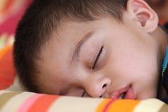 Cute kid in deep sleep stock photo