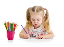 Cute kid drawing. With color pencils Royalty Free Stock Photos