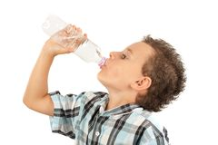 Cute kid drinking water. Beautiful kid drinking water, isolated on white background Royalty Free Stock Images