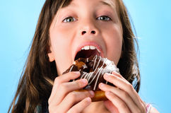 Cute kid eating donut Stock Image