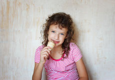Cute kid eating ice cream. Stock Photography