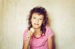 Cute kid eating ice cream. Stock Image