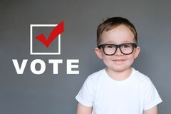 Cute Kid encouraging others to register and vote royalty free stock photo