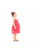 Cute kid in a fancy dress looking up. Profile shot of a cute kid in fancy dress looking up isolated on white background Royalty Free Stock Photo