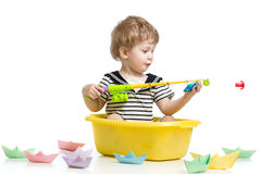 Cute kid fishing Royalty Free Stock Image