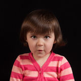 Cute kid with funny face. On the black background Royalty Free Stock Photo