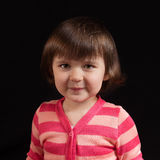 Cute kid with funny face. On the black background Royalty Free Stock Images