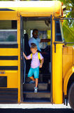 Cute kid is getting on the bus, ready to go to school Royalty Free Stock Photography