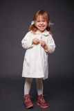 Cute kid girl. Posing over grey Royalty Free Stock Photography