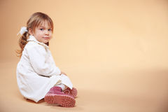 Cute kid girl. Posing over beige Royalty Free Stock Photography