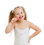 Cute kid girl brushing teeth isolated Stock Photos